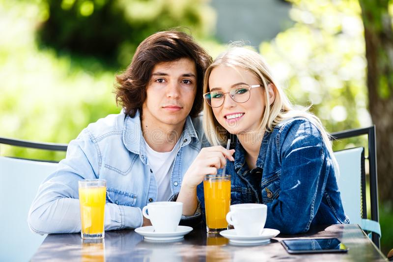 Young romantic couple spending time together - sitting in cafe`s royalty free stock images