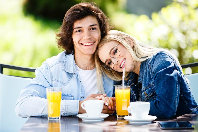 Young romantic couple spending time together - sitting in cafe`s royalty free stock photography