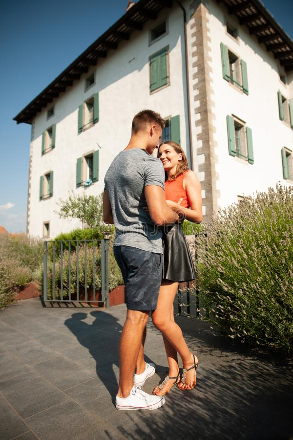 Young romantic couple standing on a garden near lavender plants stock image