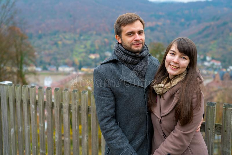 Young romantic couple standing on top of the hill stock image