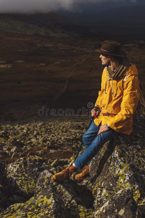 Young romantic tourist dreaming while leaning on the stone stock photo