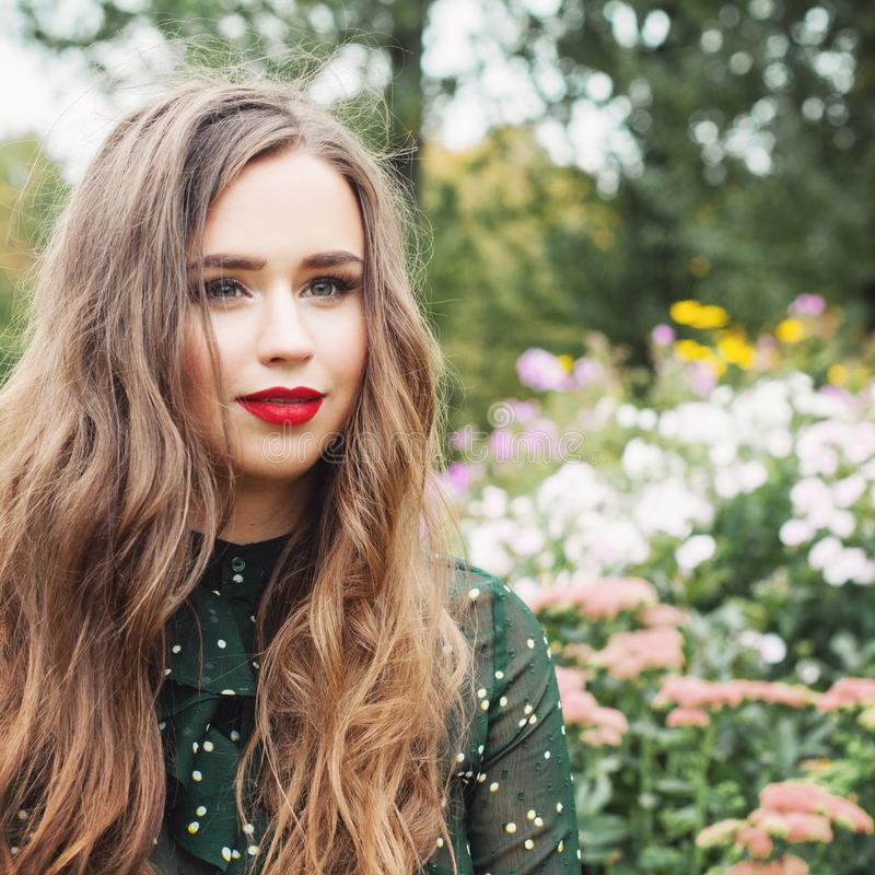 Young romantic woman outdoors, portrait. Girl in flowers garden stock photos