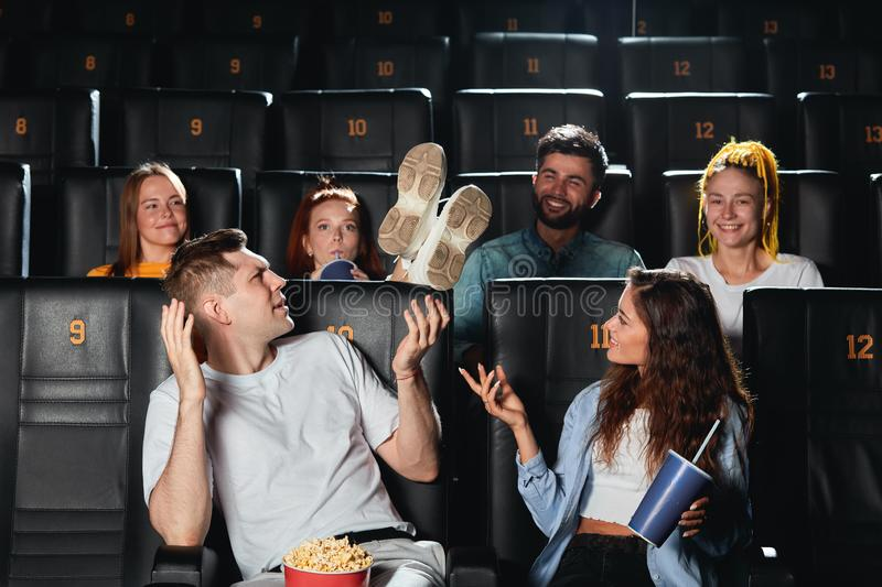 Young rude, drunk men holding his feet on the seat stock photo