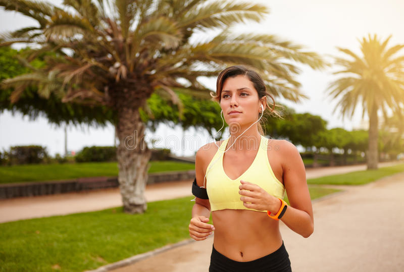 Young runner listening to music while doing sport royalty free stock photos