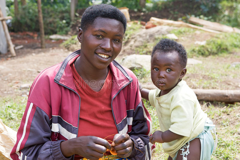 Young rwandan mother with child. 2010 estimates place Rwanda's population at 11,055,976. The population is young: an estimated 42.7% are under the age of 15 stock image