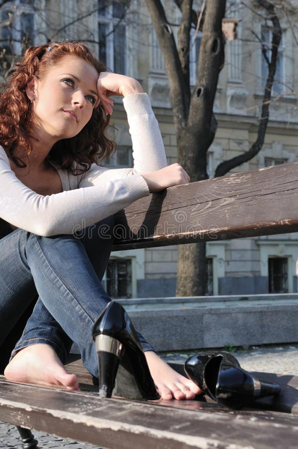 Young sad dreaming woman outside royalty free stock images