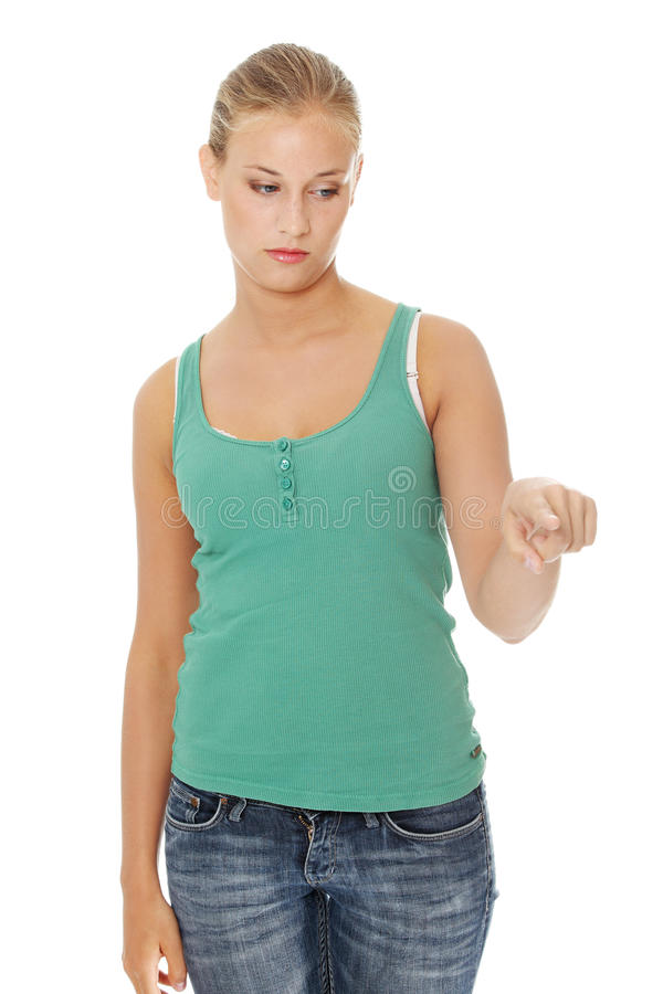 Download Young Sad Student Girl Pointing On Something Stock Photo - Image: 21263412