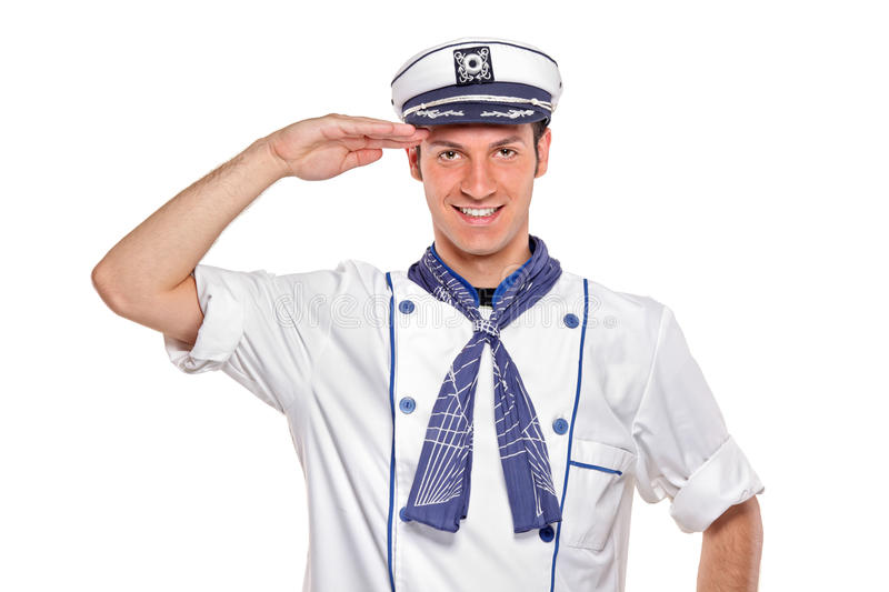 Young sailor saluting. Isolated on white background stock photos