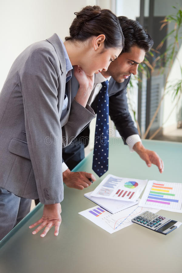 Download Young Sales Persons Studying Their Results Stock Image - Image: 22236501
