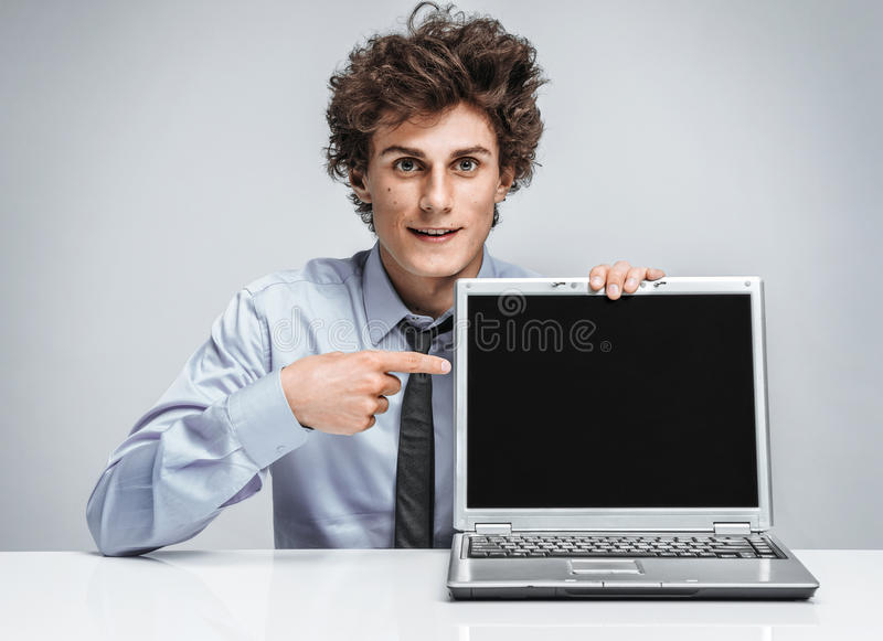 Young salesman showing at screen laptop royalty free stock image