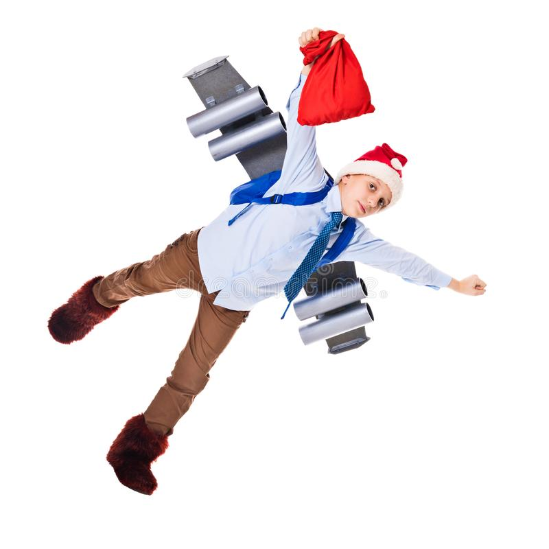 Young Santa Claus flying with presents for Christmas. On a jetpack. Isolated on white royalty free stock image