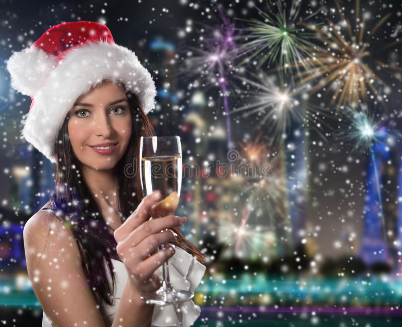 Young Santa girl with champagne glass stock photos