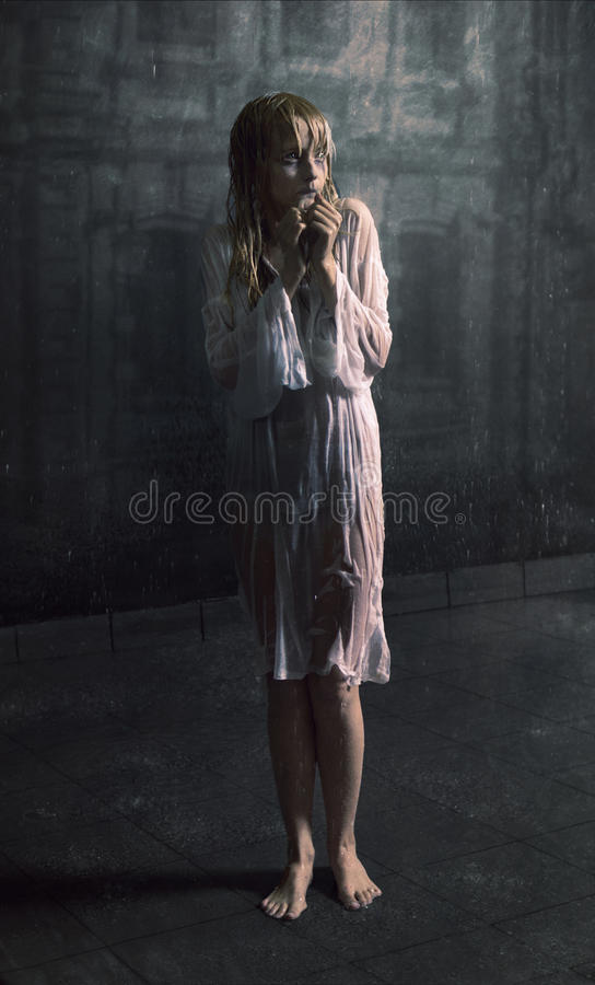 Download Young Scared Girl Under The Rain Stock Photo - Image: 20305516