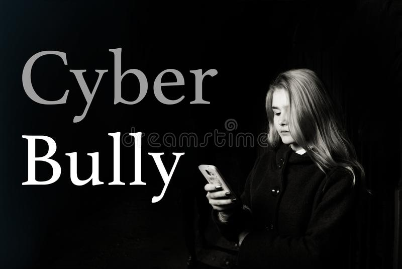Young scared teenager girl looking worried and desperate to mobile phone as internet stalked victim abused and stock photography