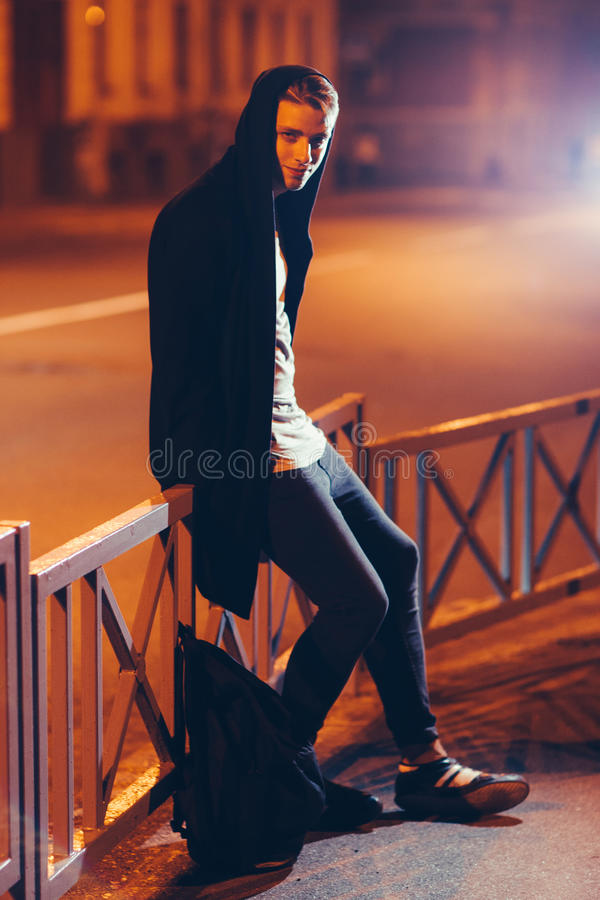 Young scary casual student in hood outdoors royalty free stock images
