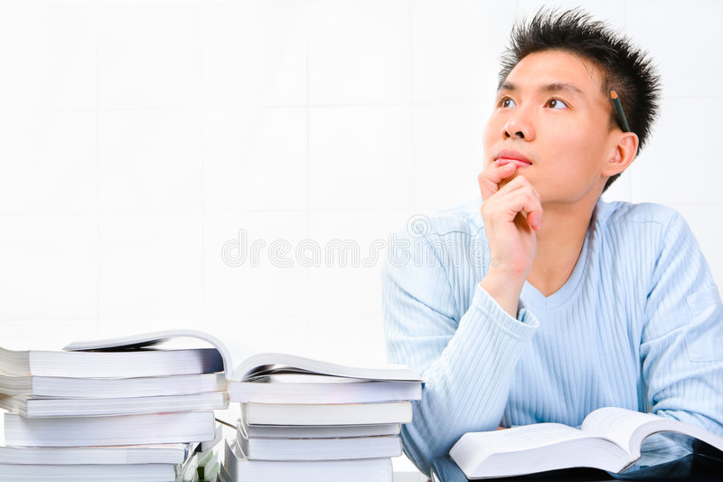 Young scholar looking for idea royalty free stock images
