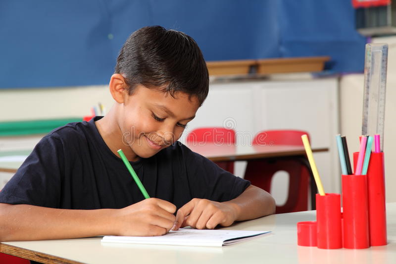 Download Young School Boy 10 Writing At His Classroom Desk Stock Image - Image of shirt, learning: 16699195