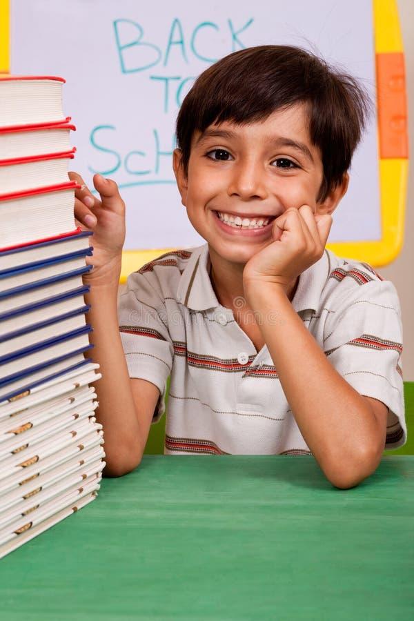 Young school kid smiling at camera royalty free stock photos