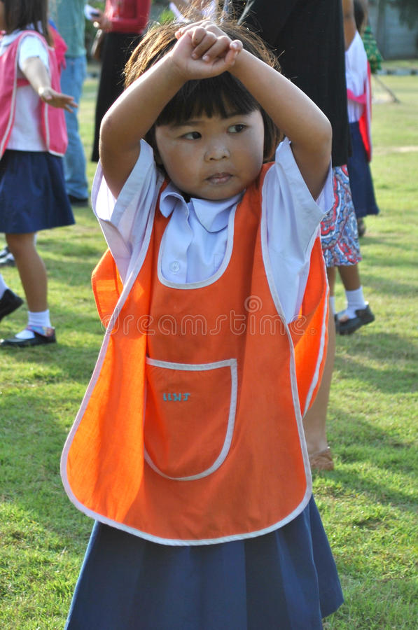Young school student in Thailand dancing royalty free stock photography