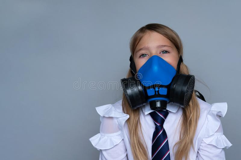 Young schoolchild in gasmask closeup portrait stock image