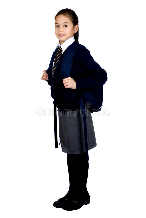 A young schoolgirl with her rucksack stock image
