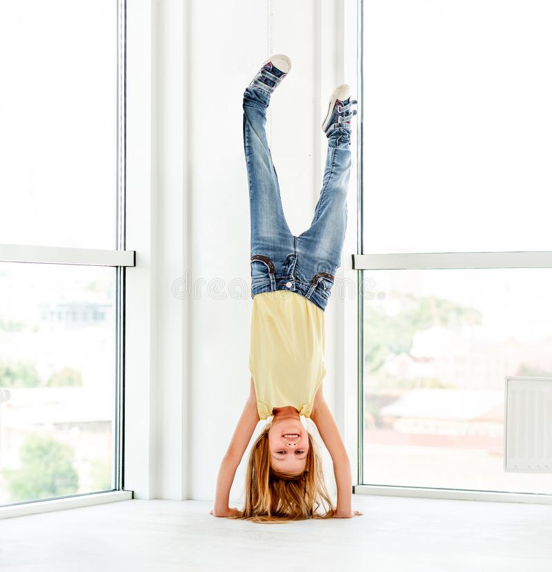 Little kid girl making hand stand royalty free stock photos