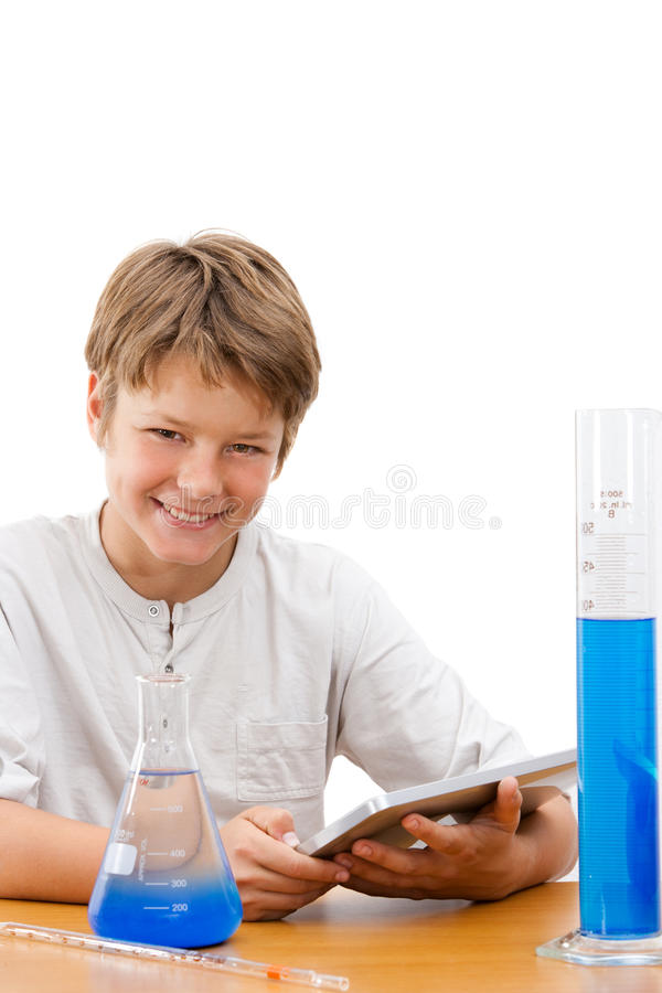 Young science student with tablet doing homework. royalty free stock photos