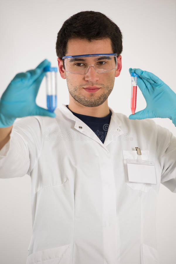 Young scientist holds tubes royalty free stock image