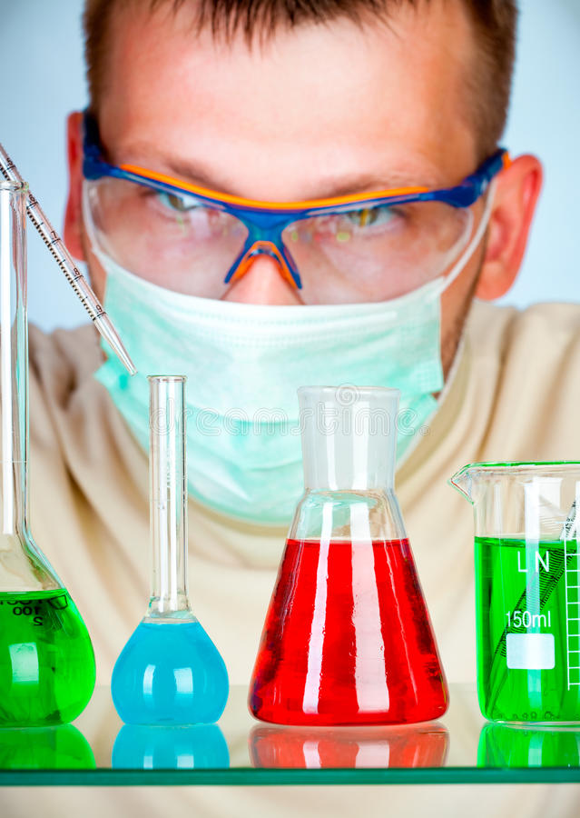 Download Young Scientist In Laboratory With Test Tubes Royalty Free Stock Photography - Image: 12398727