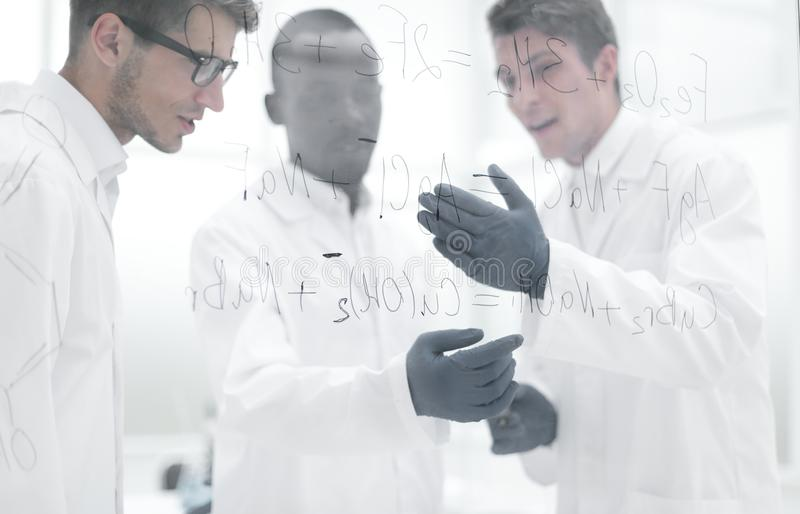 Young scientist makes notes on a glass Board. Concept of education royalty free stock photography