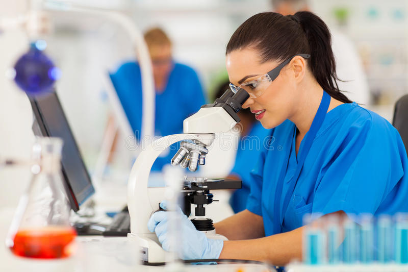Young scientist microscope royalty free stock photography