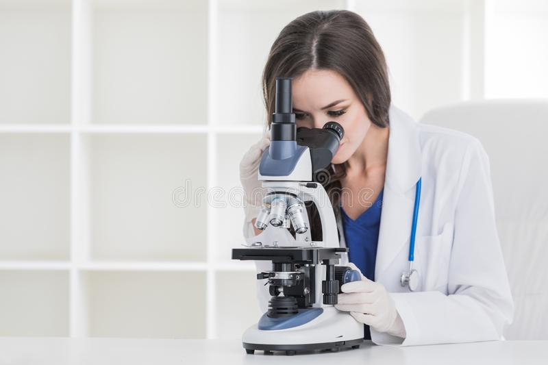 Young scientist with microscope royalty free stock images
