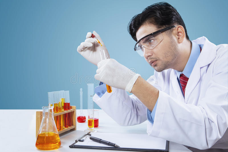 Young scientist observes his research stock photography