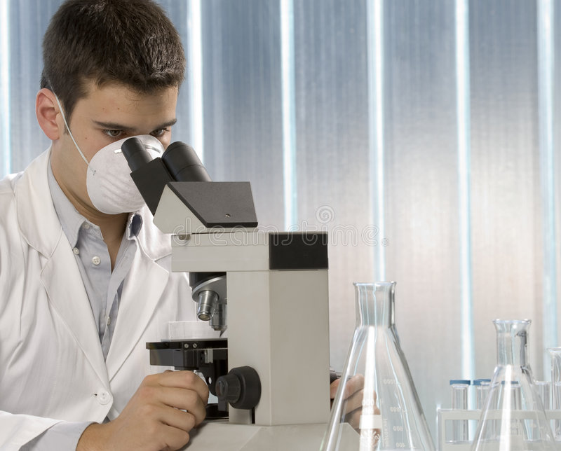 Download Young Scientist Working At The Microscope Stock Photo - Image: 6437006