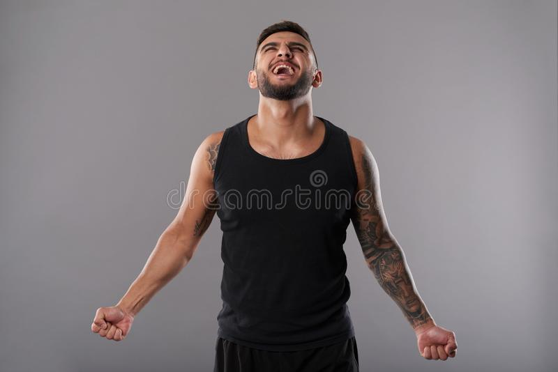 Determined screaming sportsman royalty free stock images