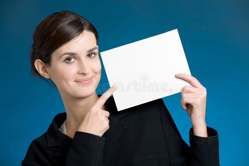 Young secretary or businesswoman with blank note card royalty free stock photos
