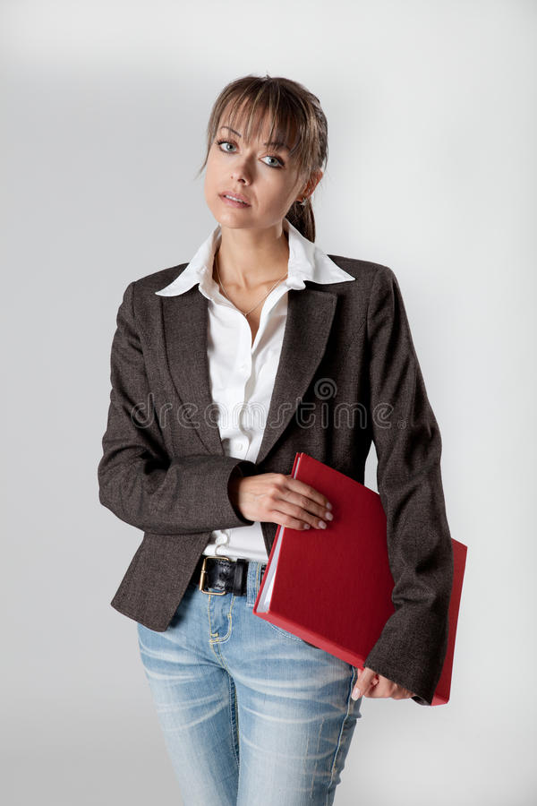 Download Young Secretary With A File Under Her Arm Stock Image - Image: 18461607