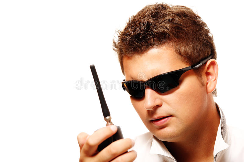 Young security man with radio transmitter. Over white background royalty free stock photo