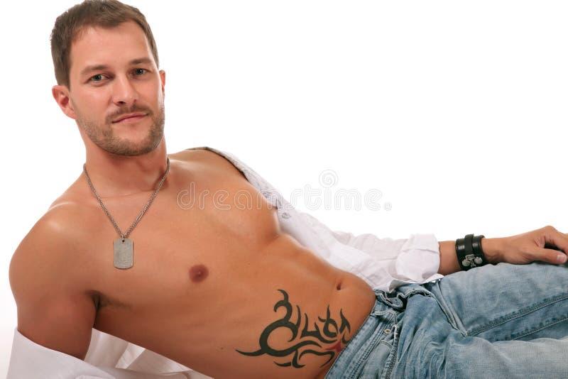 Young seductive caucasian man royalty free stock photography