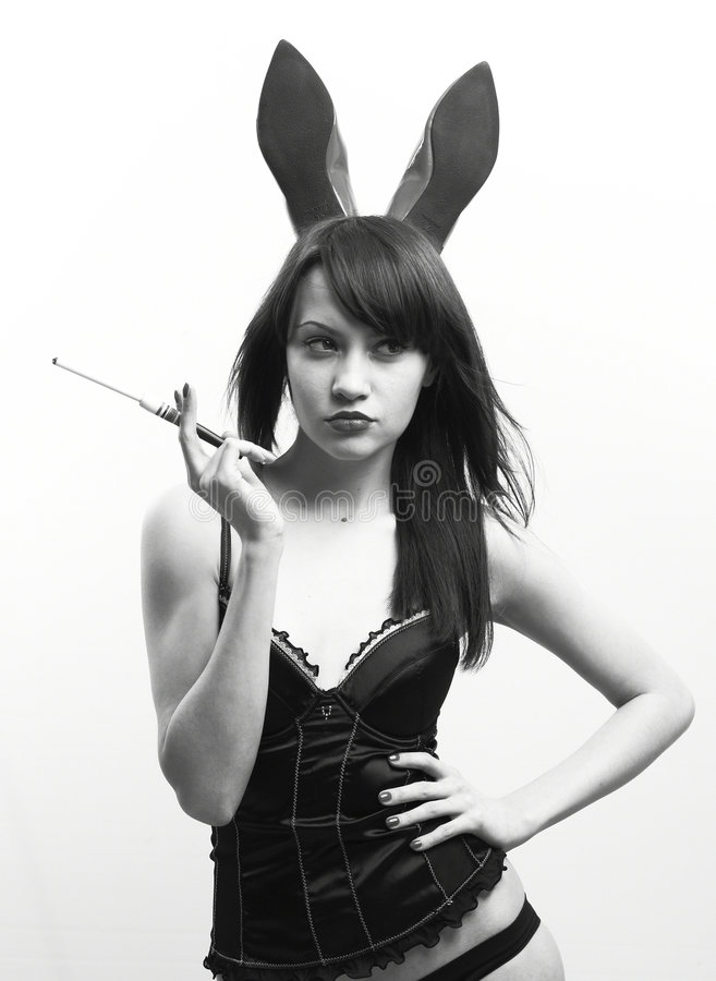 Young seductive woman with rabbit ears stock photography