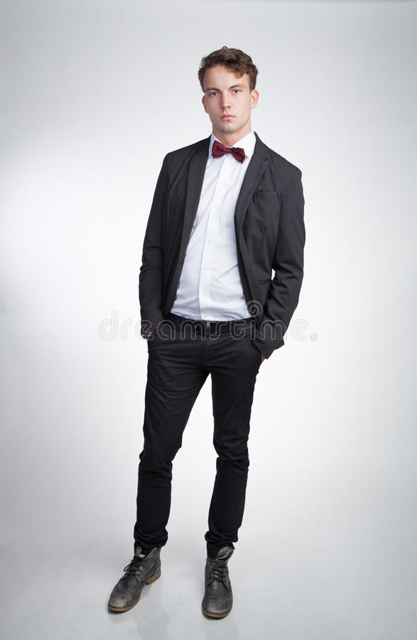 Young self-confident man. With bow tie stock photos