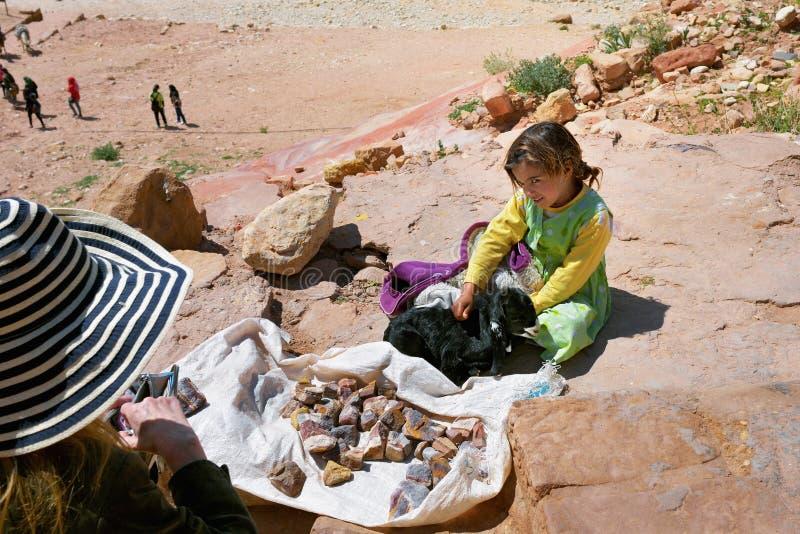 Young seller in Petra, Jordan stock image