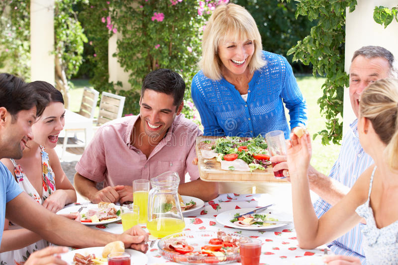 Download Young And Senior Couples Enjoying A Meal Stock Image - Image: 27200069