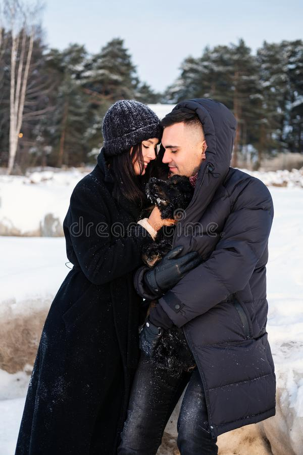 Young sensual couple in love embracing outdoor in winter park royalty free stock image