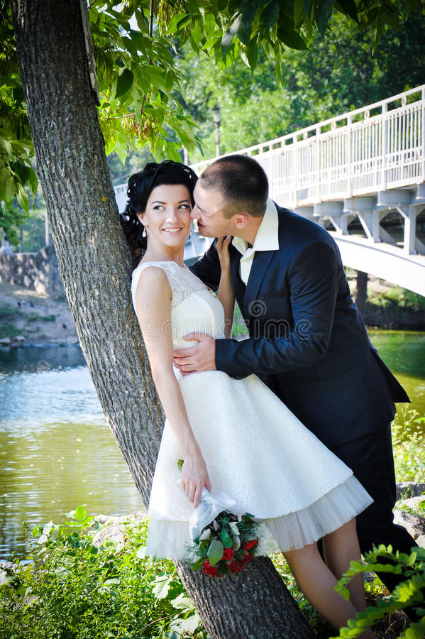 Young sensual couple in love kissing and having fun together outdoor in summer park. stock photos