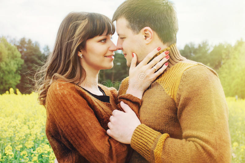 Young sensual couple in love outdoor into the depth of beautiful royalty free stock images
