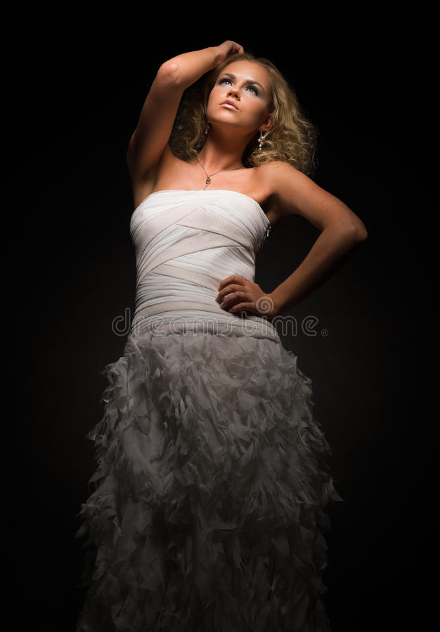Young and sentimental. Fashion photo of young and charming woman in white dress stock photography