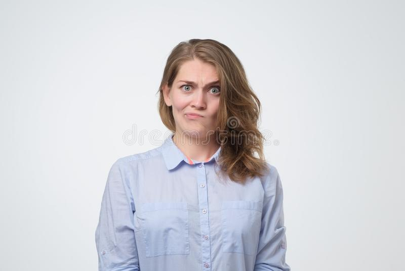 Young serious angry woman with long hair looking suspicious royalty free stock photos