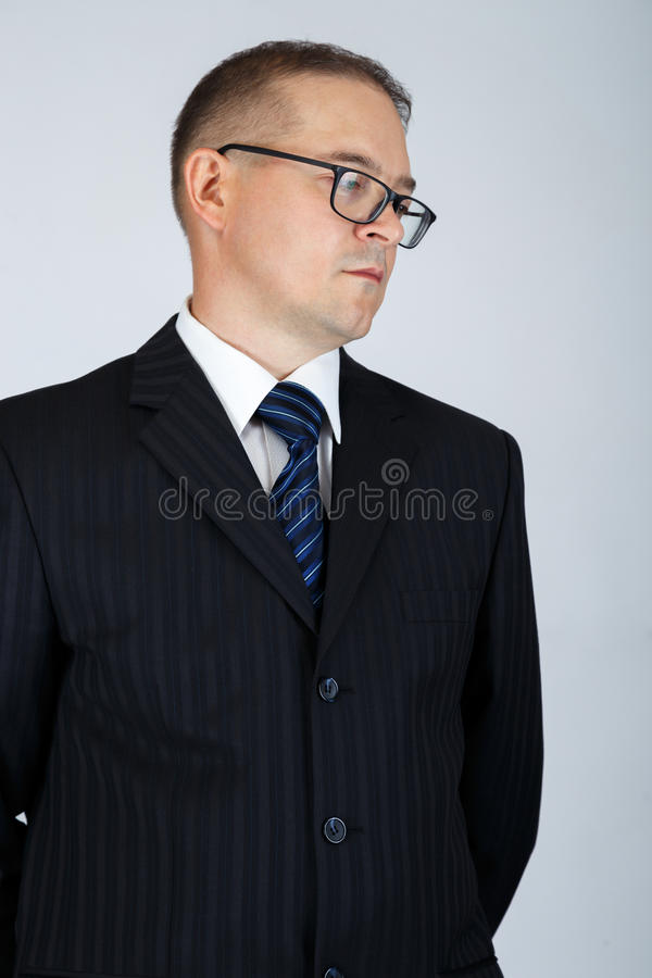 Young serious business man is thinking stock photography