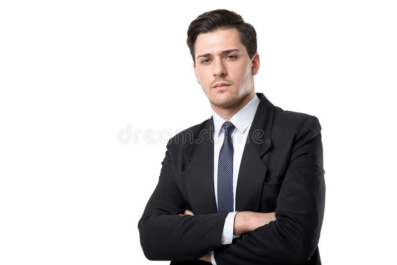 Young serious businessman in tie and suit poses royalty free stock photo